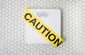 Scale with Caution sign