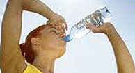 Woman with Multiple Sclerosis (MS) drinking water to cool down