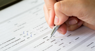 person filling out health form