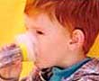 little boy drinking juice