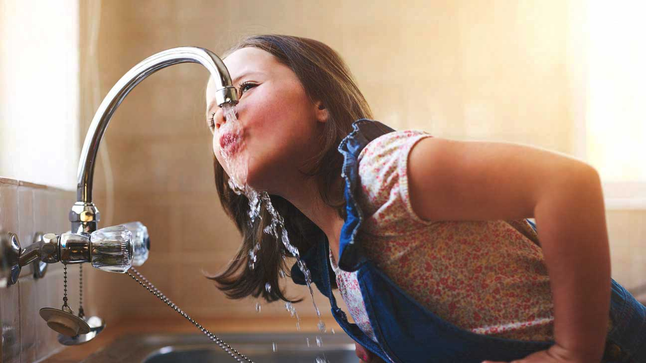 Girl Drinking Water From Tap