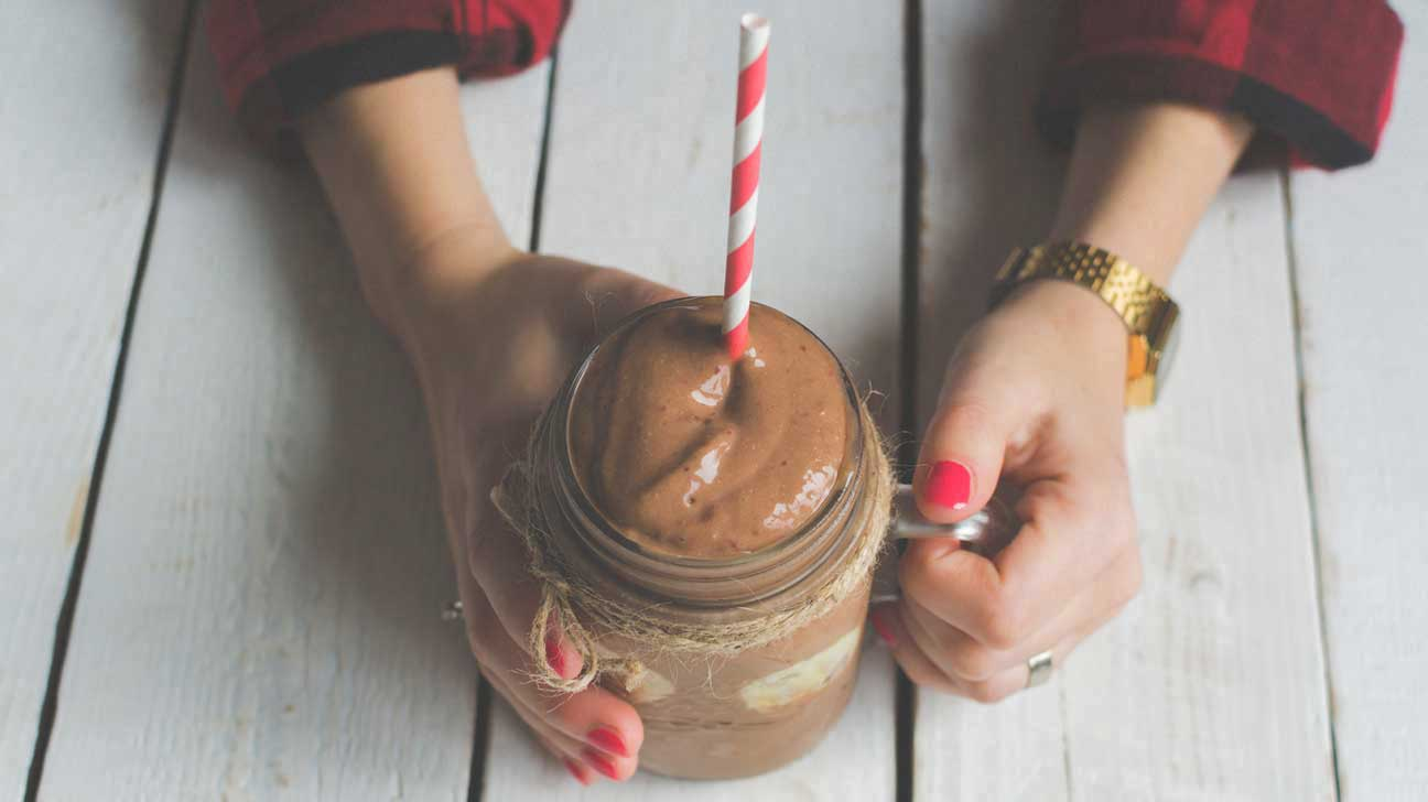 Hands Holding Chocolate Smoothie