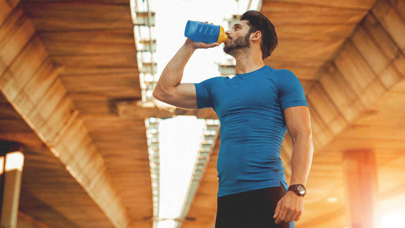 Man Drinking Pre-Workout Supplement