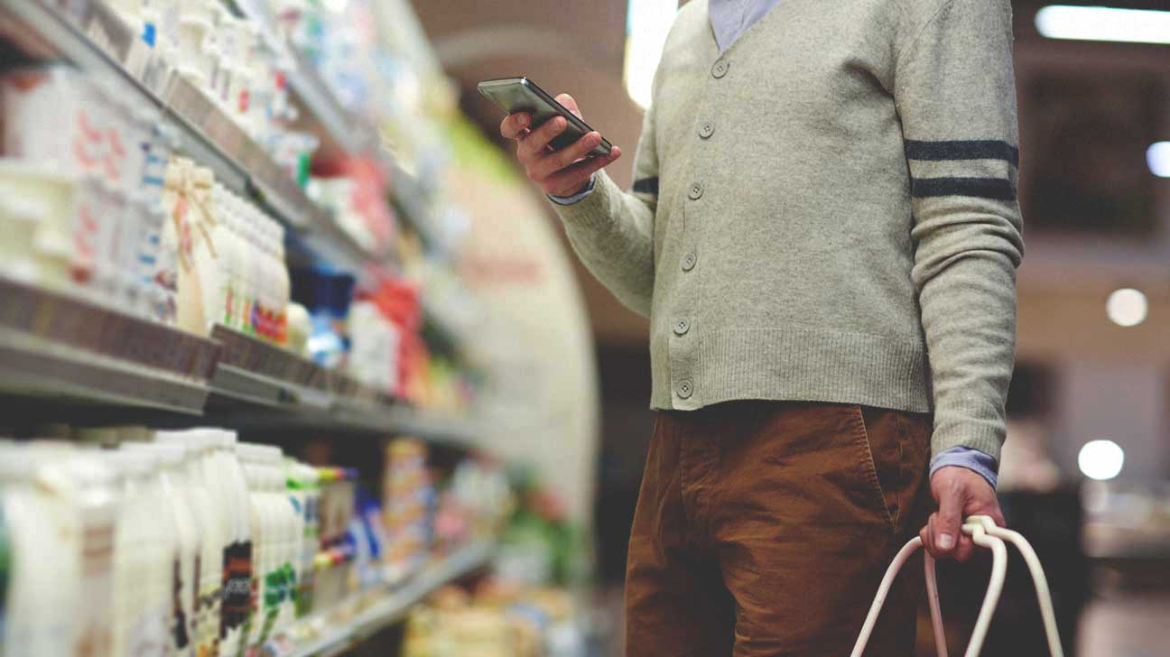 Man Looking at Grocery Shopping List