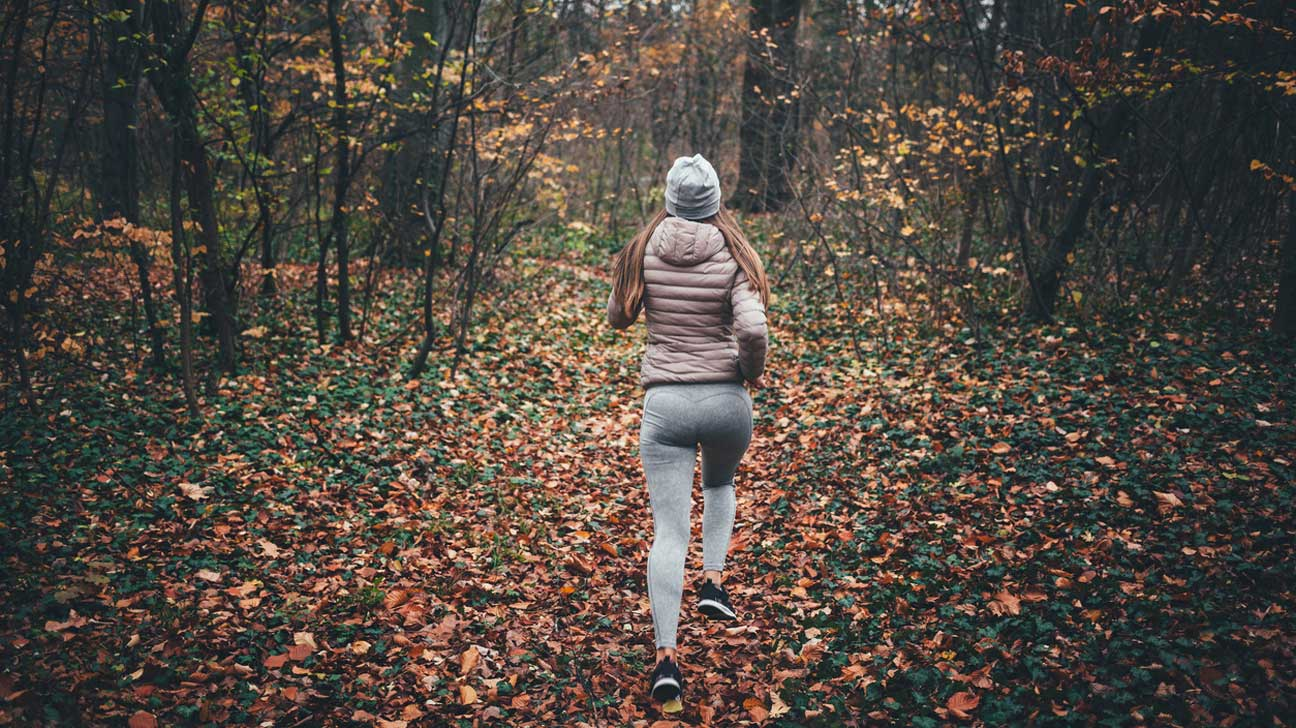 Woman Running in Woods
