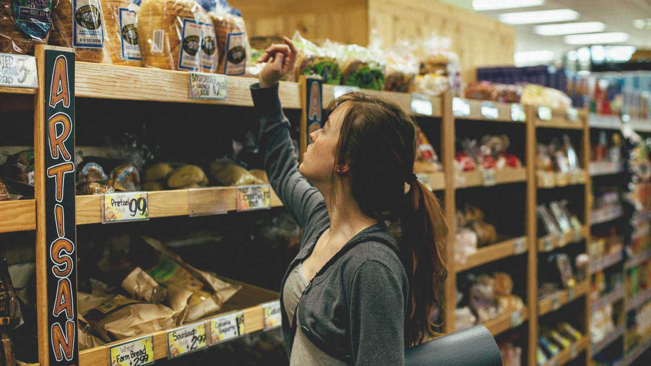 Young Woman Buying Bread