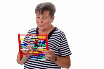 An older woman playing a brain-stimulating game.