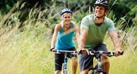 man and woman biking outside