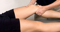 physical therapist stretching out patients hamstring