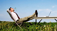 man relaxing in an open field