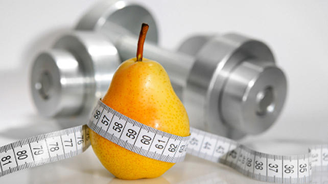 pear with weights wrapped in measuring tape