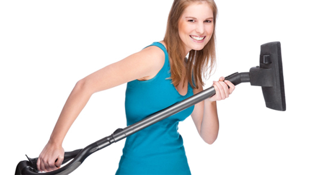 woman lifting vacuum cleaner