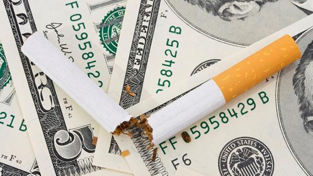 broken cigarette on paper money