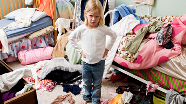 mad girl standing in messy room