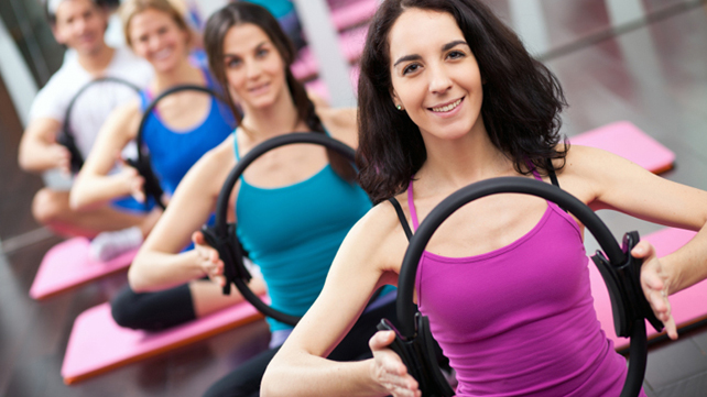 women in group fitness class