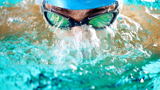 close-up of racing swimmer