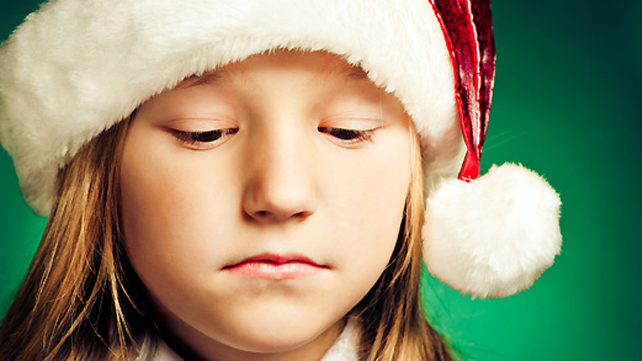 depressed girl with a santa hat