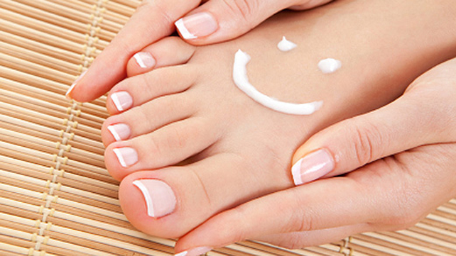bare foot with lotion smiley face