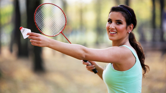 woman playing badminton outdoors