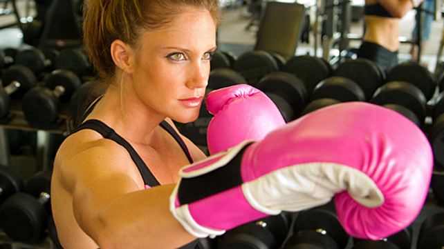 woman with pink boxing gloves