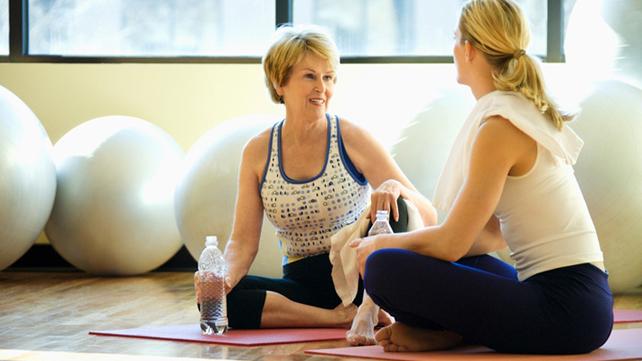 two women talking in fitness class