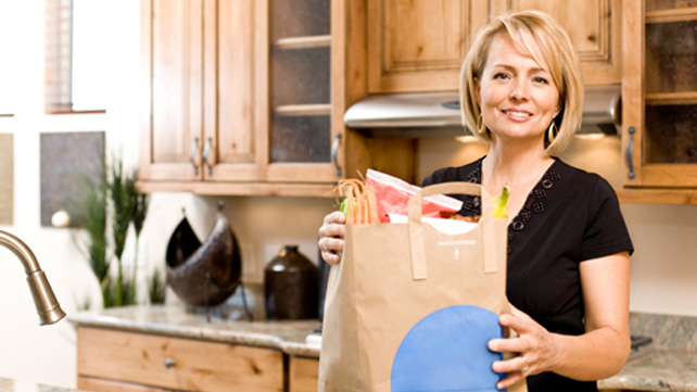 woman in kitchen with groceries