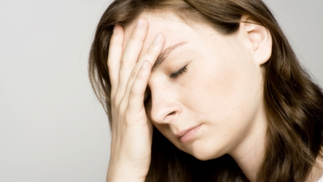 stressed woman with hand to her head