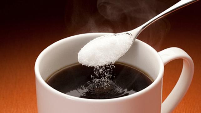 spoonful sugar going into coffee