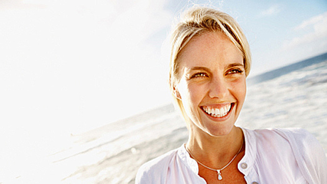woman smiling on a sunny beach