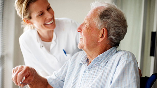 caregiver talking to elder man