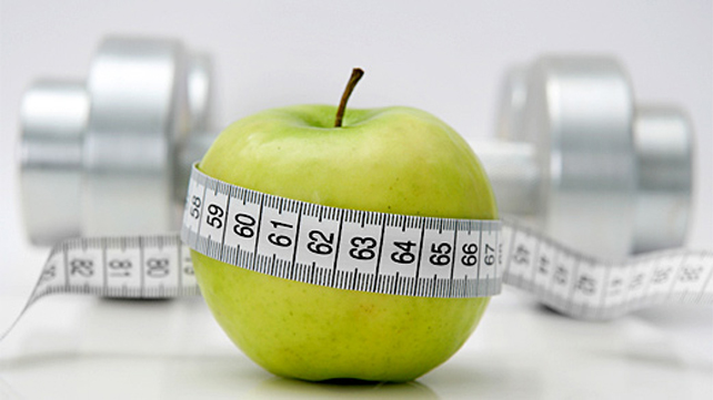 apple with measuring tape around it