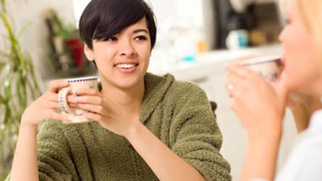 women conversing over coffee