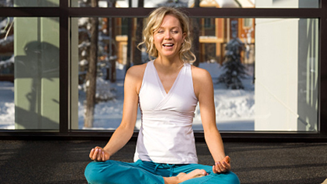 woman laughing during yoga