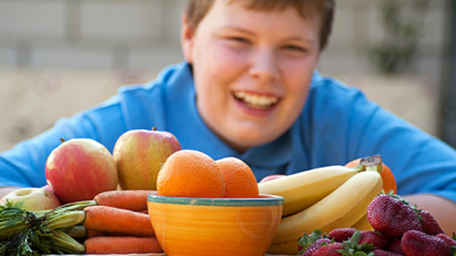 obese kid with fruit