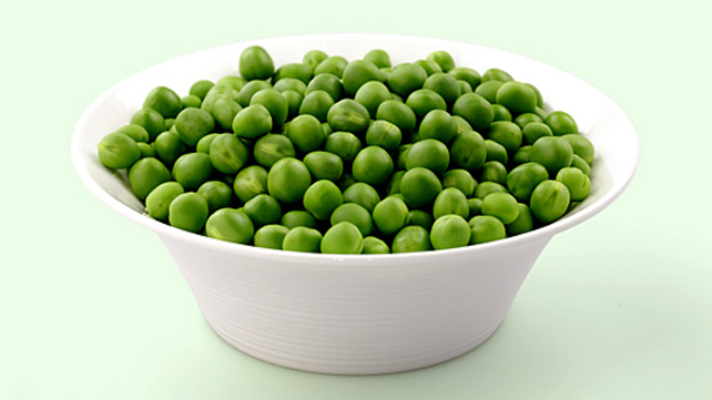 a bowl full of green peas