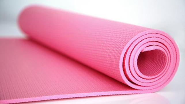unrolling yoga mat