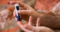 A blood sample being taken from a fingertip.