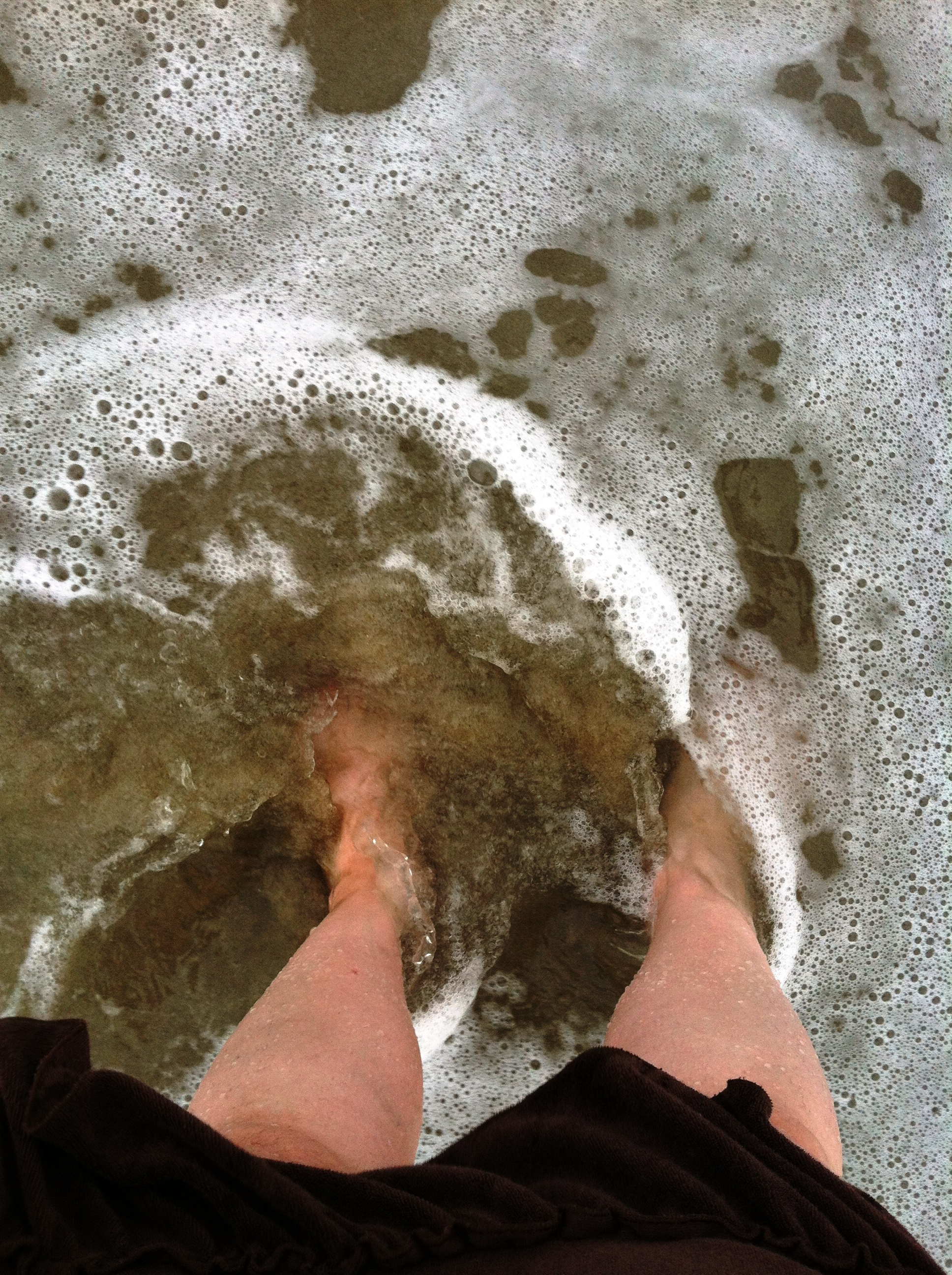Blogger Elizabeth Santeramo dips her feet in the Atlantic Ocean at the New Jersey shore
