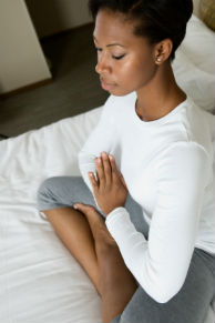 Young black woman meditating