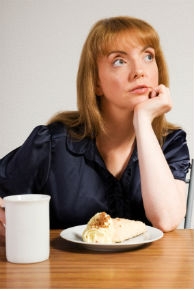 Woman contemplating food