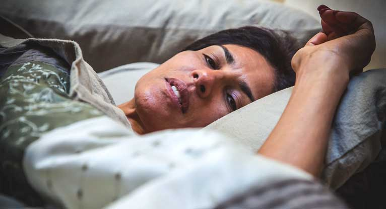 It's Not Just Hot Flashes. Menopause Can Disrupt Your Sleep