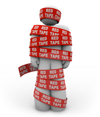 An image of a person wrapped up in red tape.