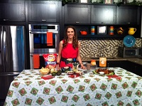 Diet Diva Tara Gidus stands in front of a weekend tailgating spread