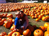 Tara Gidus and her son at a pumpkin patch