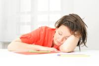 A woman who is falling asleep at her desk. Image courtesy of iStockphoto.com