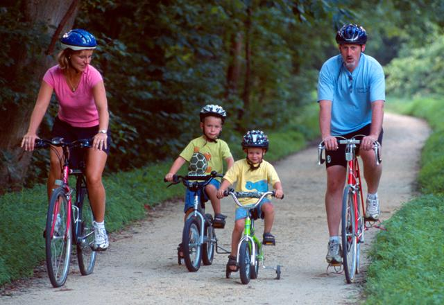 A family riding bikes