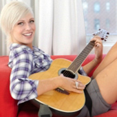 Model CariDee English with a guitar.