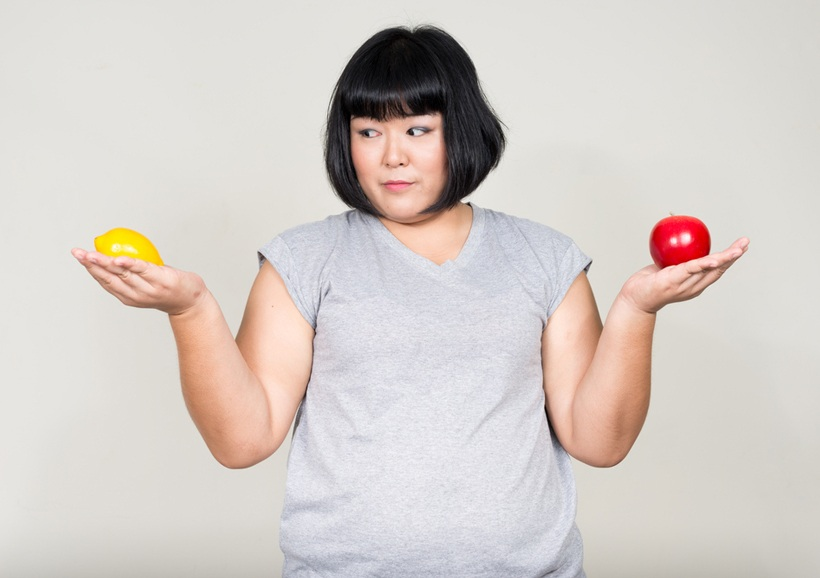 Asian Woman Holding Lemon Apple