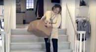 woman with osteoarthritis carrying a box down stairs