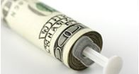 needle surrounded by dollar bills